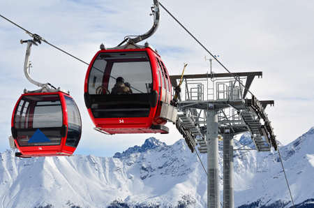 Red cable car in the skiing resort in Alps