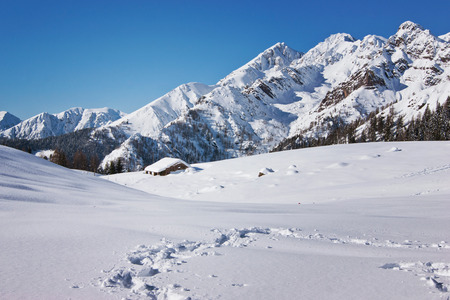 hobby hut: Excursion on the snowy paths in the beautiful setting on the winter landscape of the Alps Orobie into resort Cusio, Upper Valley Brembana Stock Photo