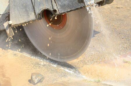 Cutting asphalt road to repair a 12 inch water main failure on Harvard Ave in Roseburg OR