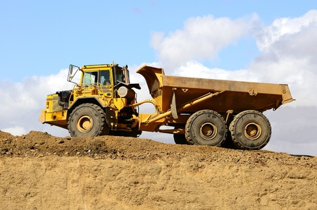 dump truck: A large articulating dump truck at a new road project in Oregon