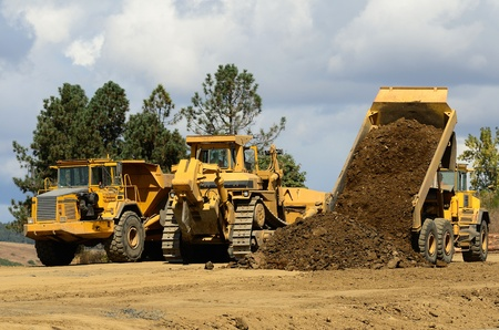 A large track bulldozer and a large articulating dump truck at a new road project in Oregon Reklamní fotografie