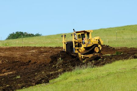 preperation: A large bulldozer grading a hillside in preperation for a major highway intersection project in Oregon Stock Photo