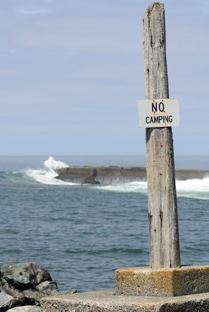 coquille: No Camping sign at the South Jetty of the Coquille River bay near Bandon Oregon