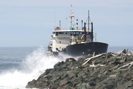 coquille: Large ship entering the entrance to the Coquille River from the Pacific Ocean