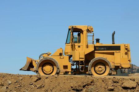 vibroroller: Large compactor tractor working on a new freeway interchange near Roseburg Oregon