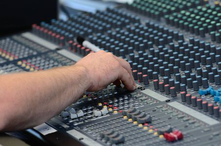 audio mixer: Sound mixing board during a musical performance at a fair