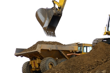 Large track hoe loading an articulated large dump truck at a new road project in Oregon