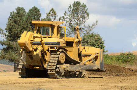 A large track bulldozer building up elevation at a new road project in Oregon Stock Photo - 10945835