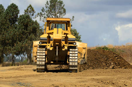 A large track bulldozer building up elevation at a new road project in Oregon Stock Photo - 10945821