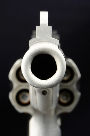 Stairing down the barrel of a 44 Magnum pistol photo