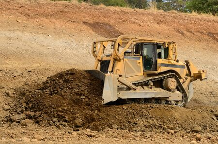 A large bulldozer working the grade for a new road and freeway interchange near Roseburg Oregon photo
