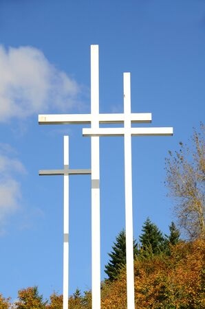 White crosses against a blue sky and clouds in Portland Oregon photo