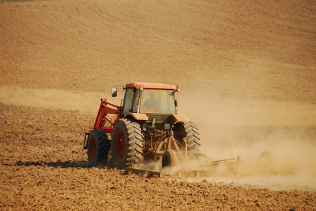 Agricultural tractor working a field for winter wheat Stok Fotoğraf - 11740607