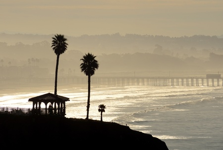 Sunrise on a cliff overlooking the Pismo Beach Pier in Southern California. Stock Photo - 11919208