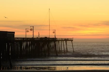 The Pismo Beach, CA pier near downtonw at sunset. photo
