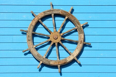 restuarant: Large ship steering wheel on the side of a seafood restuarant Stock Photo