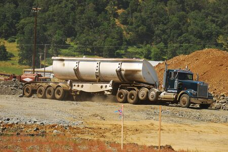 Large dump truck working at a new freeway interchange project near Roseburg Oregon