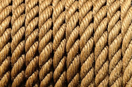 rope coiled on a Large suction strainer on a old fire engine