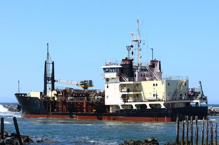coquille: Large research vessel checking the depth of the shipping channel at the bar of the Coquille River near Bandon Oregon Editorial