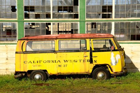 FORT BRAGG, CA - MARCH 06  A old Volkswagon bus used by the California Western Railroad sits at an old mill site March 06, 2011 in Fort Bragg, CA   Stock Photo - 12904057