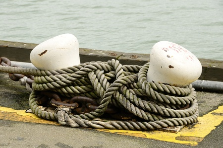 Rope moaring of a large military ship on display in San Francisco CA harbor  Stock Photo