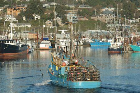 crab pot: Commercial Crabbing Boats returning with catch into Yaquina Bay, Newport Oregon