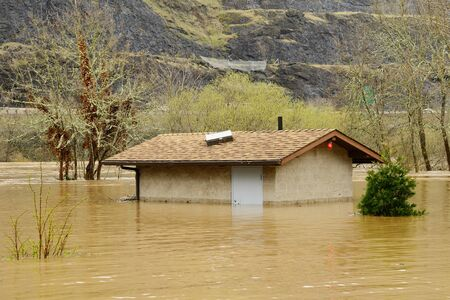 Bathroom building under water as the South Umpqua River floods in late winter