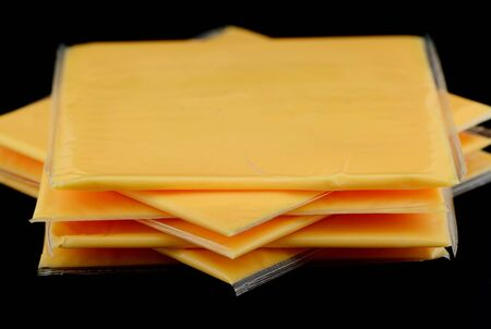 Several slices of american cheese in the studio photo