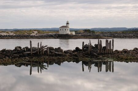 Coquille River Lighthouse and Pilings, Bandon Oregon, Low tide photo