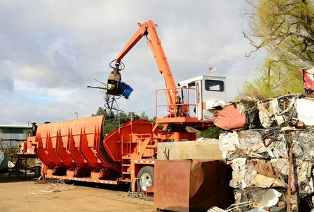 Self contained loader crusher unit processing low grade metal into blocks for further recylcing Stock Photo - 13460597