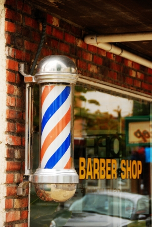 shop sign: Candy Cane barber shop sign outside of the Hub Barber Shop on Jackson Street in Downtown Roseburg Oregon  Stock Photo