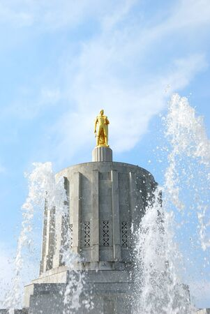 Oregon State Capitol building built in 1938, atop the marble dome sits GOLD PIONEER in late summer. Salem Oregon