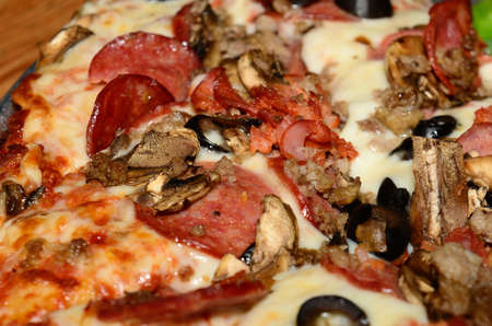 Detail of a meat combination pizza Stock Photo - 13749075