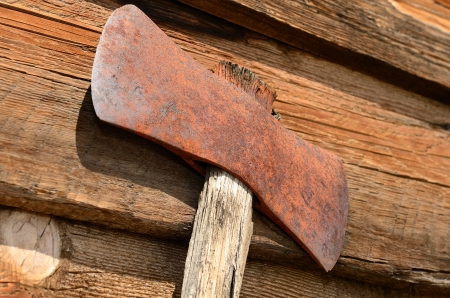 double headed: Old double headed loging axe on a wood cabin wall