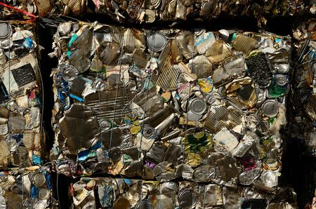 salvage yard: Block of recycled aluminum and tin can at a metal scrap recycle yard Stock Photo