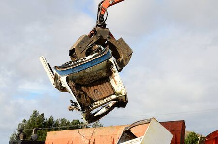 salvage yards: Self contained loader crusher unit processing low grade metal into blocks for further recylcing