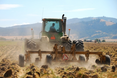 Plowing the field in preparation for Winter Wheat in the Willamette Valley between Eugene and Albany Oregon photo