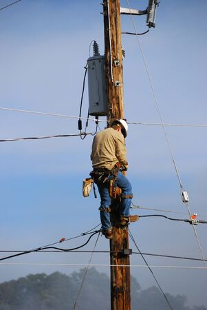 lineman: Shutting Down the Power Stock Photo