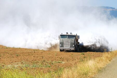 Agricultural lime being spread on a newly created field in the Garden Valley area of Roseburg Oregon
