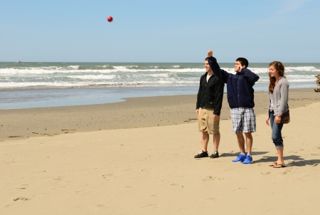 bocce ball: Young adults playing Bocce Ball on the beach near Bandon Oregon