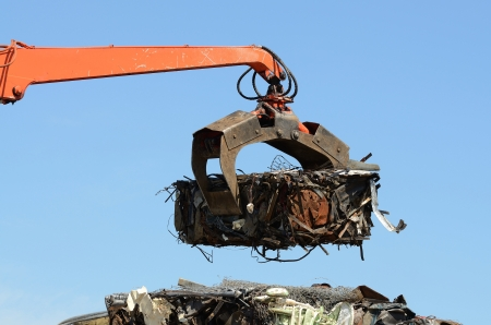dump yard: A claw on a compactor moves light weight metal at a recycle yard in Oregon Stock Photo