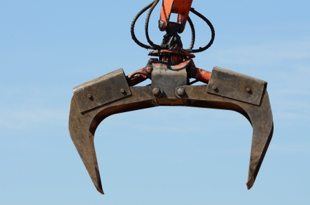 salvage yard: A claw on a compactor moves light weight metal at a recycle yard in Oregon Stock Photo