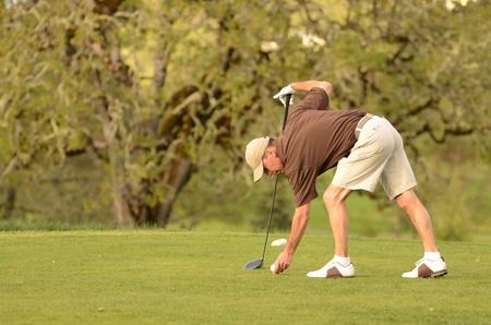 A amature golfer competes on a 18 hole golf course photo