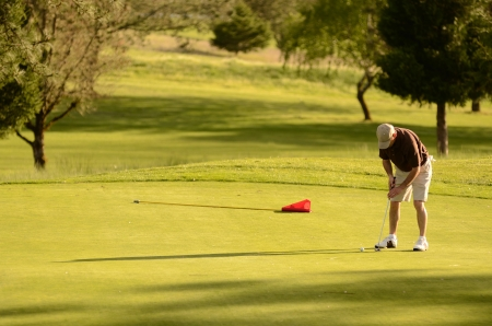 A amature golfer competes on a 18 hole golf course