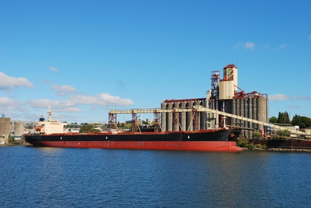 willamette: Alam Pesona getting her load of grain on the Willamette waterfront in Portland Oregon  Editorial