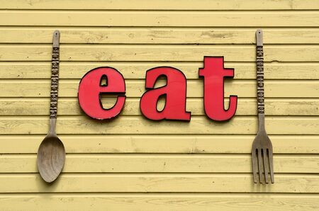 Eat here sign outside of a old town restuarant outside Portland Oregon in the Willamette Valley Stock Photo - 14294607
