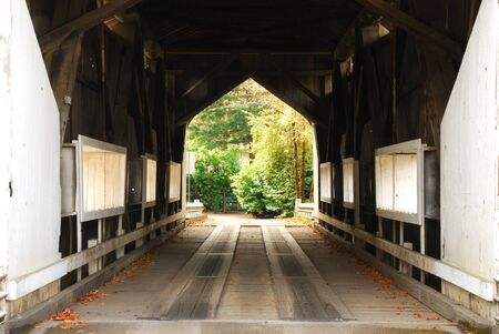 Cavitt Creek Covered Bridge, circa 1943, along Little River Road near Glide Oregon  Stock Photo