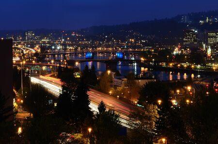 eastbank: Downtown area of Portland Oregon at night showing its Bridgetown nickname Stock Photo