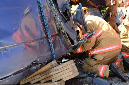 Firefighters work on an extrication using a hydraulic rescue tool photo