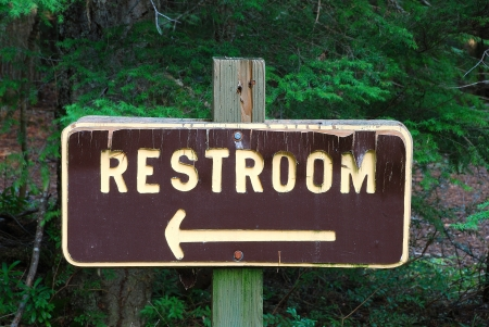 A Restroom sign in the National Forest photo